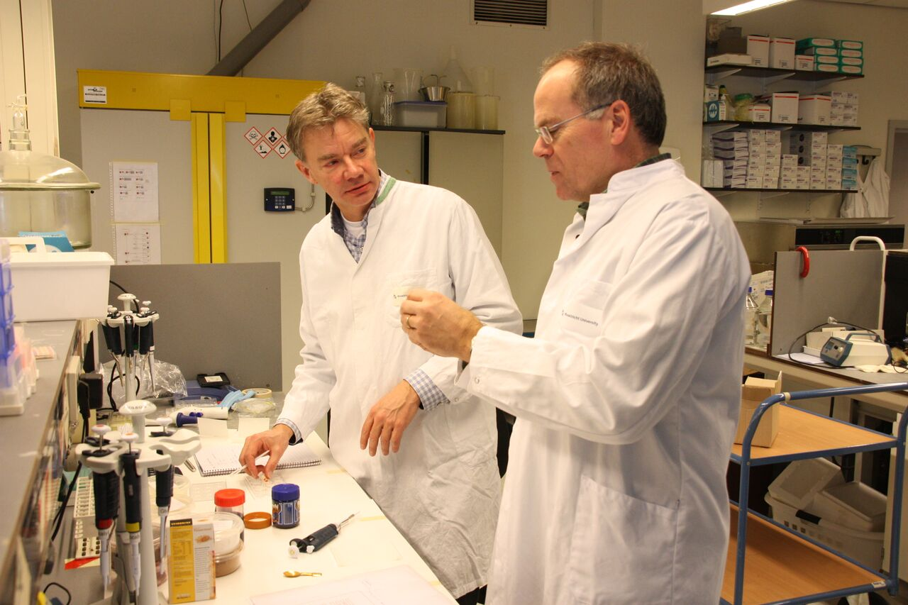 Peter Verstrate, left and Mark Post, right, in the lab at Maastricht University.