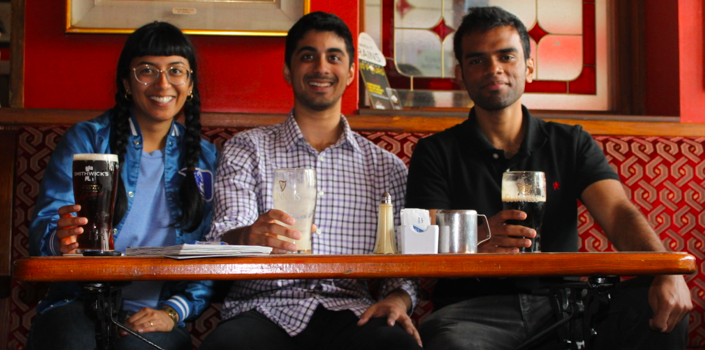 Isha, Ryan and Perumal sitting together drinking beer