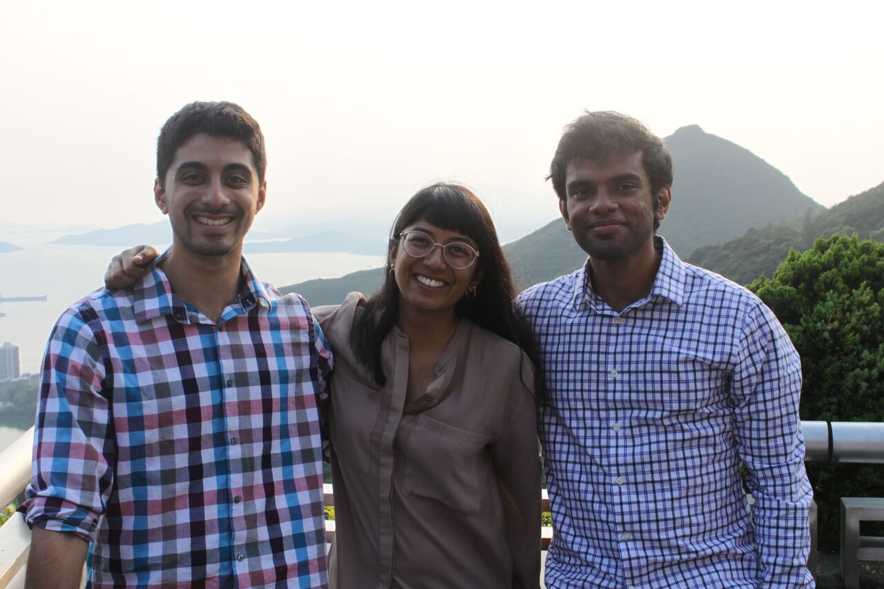 Ryan, Isha, and Perumal standing with eachother in Hong Kong