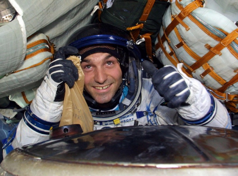 Mark Shuttleworth in astronaut suit in a space shuttle