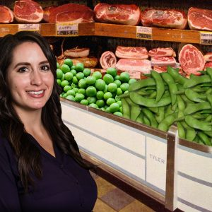 Stephanie Kawecki in front of meat counter