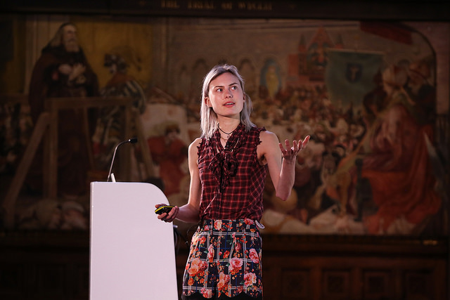 Abi Glencress speaking on a stage